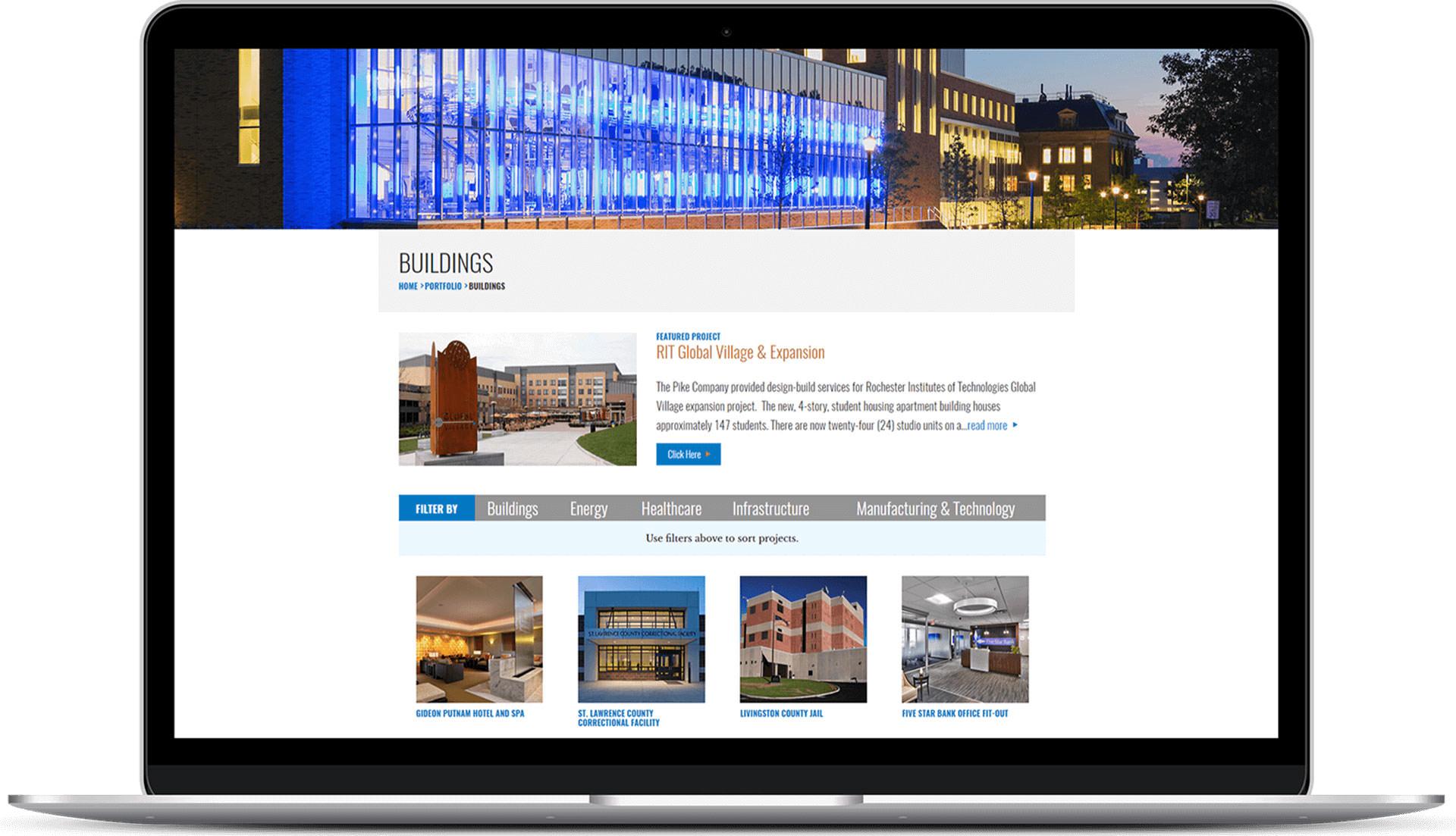 Pike Company Buildings portfolio page displayed on laptop