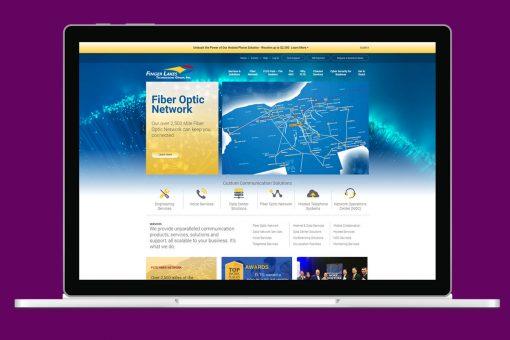 FLTG website on laptop, purple background